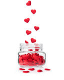 Red hearts falling in glass jar, valentine concept Stock Image