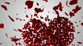 Red hearts falling on white surface stock video footage