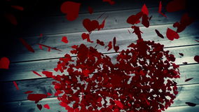 Red hearts falling on wooden surface stock video