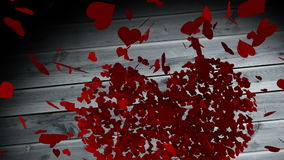 Red hearts falling on wooden surface stock video footage