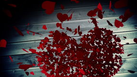 Red hearts falling on wooden surface with valentines message. Digital animation of Red hearts falling on wooden surface with valentines message stock footage