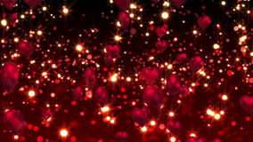 Red hearts floating against glittering background stock video footage