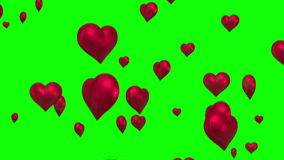 Red hearts floating against green screen stock video