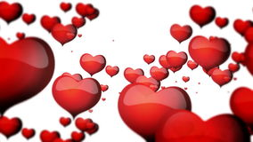 Red hearts floating on white background for Valentine's day stock footage