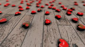 Red hearts on the floor bokeh stock video footage