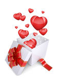 Red hearts fly out of an open gift box Stock Photography