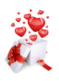 Red hearts fly out of an open gift box Stock Image