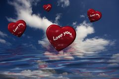 Red hearts flying in the sky Royalty Free Stock Photo
