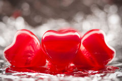 Red hearts on the foil Royalty Free Stock Photography