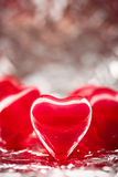 Red hearts with foil background Royalty Free Stock Photos