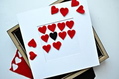 Red hearts with frame in the white background Stock Photo