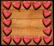 Red Hearts Frame on Wooden Boards. Many wooden red hearts on wooden damaged boards with nails Stock Images