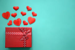 Red hearts and gift box on a background stock photo