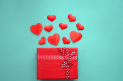 Red hearts and gift box on a background royalty free stock images