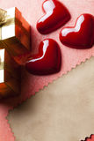 Red hearts, gift boxes and blank paper sheet Stock Image