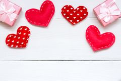 Red hearts and gift on white wooden background for Valentines day, copy space, top view stock image