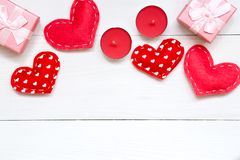 Red hearts and gift on white wooden background for Valentines day, copy space, top view royalty free stock images