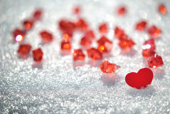 Red hearts in glittering snow Royalty Free Stock Photo