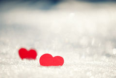 Red hearts on glittering snow Royalty Free Stock Images