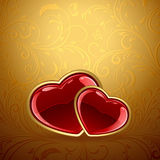 Red hearts on golden background Stock Photography