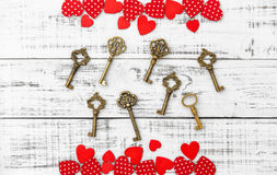 Red hearts golden keys wooden background Valentines Day Love Royalty Free Stock Photo