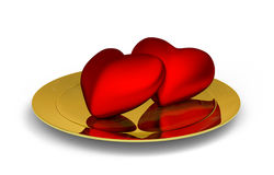 Red hearts on golden plate. Two red hearts on golden plate - 3D render isolated on white Royalty Free Stock Photo