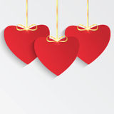 Red hearts with golden ribbon Royalty Free Stock Images