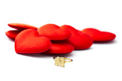 Red hearts and a golden ring Royalty Free Stock Photo
