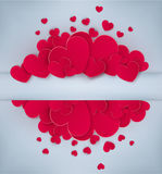 Red hearts on a gray background with a card for the text. Stock Images