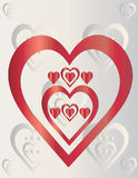 Red hearts on gray background Stock Photos
