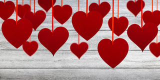 Red hearts on gray planks Stock Photos