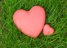 Red hearts on green grass Stock Photos