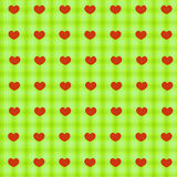 Red hearts on green tablecloth seamless background Stock Photo