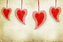 Red hearts on grunge paper Royalty Free Stock Photography