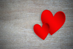 Red hearts on grunge wood Royalty Free Stock Images