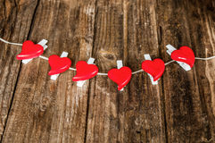 Red hearts on grunge wooden background Stock Image