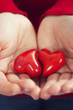 Red hearts  in hands Royalty Free Stock Photo
