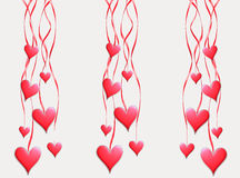 Red hearts hang on tapes Royalty Free Stock Image