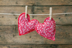Red hearts hanging on the clothesline Royalty Free Stock Photo
