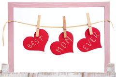 Red hearts hanging on clothesline Royalty Free Stock Images