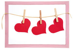 Red hearts hanging on clothesline Stock Photography