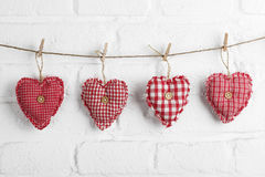 Red hearts hanging on line Royalty Free Stock Image