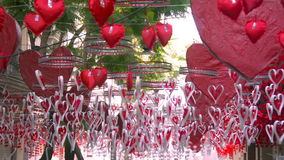 Red hearts hanging and moving in Gracia district, Barcelona stock video footage