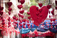 Red hearts hanging and moving in Gracia district, Barcelona. Red hearts hanging and moving in neighbourhood festival of Gracia district in Barcelona. Suitable Royalty Free Stock Photo