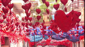 Red hearts hanging and moving in the streets of Gracia district, Barcelona stock video