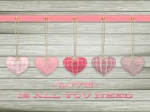 Red hearts hanging over old wood. EPS 10 Royalty Free Stock Photo