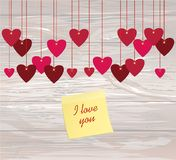Red hearts  hanging on a ribbon. Yellow sheet of paper for notes. Sticker. Valentine`s Day. Vector illustration. Greeting card with empty space for your label Stock Image