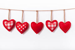 Red hearts hanging on white background Stock Photo