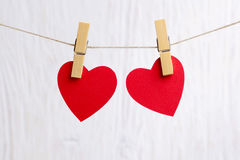 Red hearts hanging on wooden background Royalty Free Stock Photos