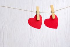 Red hearts hanging on wooden background Royalty Free Stock Photo